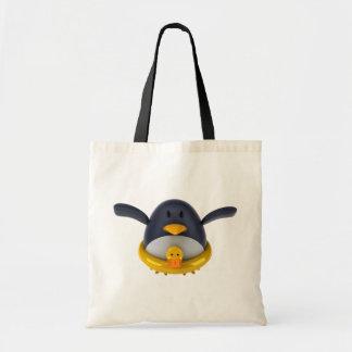 Pinguin mit einer Gummiente Tragetasche