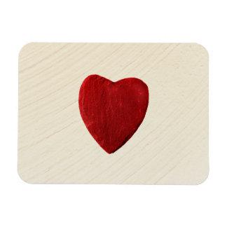 Putzhintergrund mit Herz Magnet