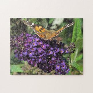 Puzzlespiel - Schmetterling auf lila Blume