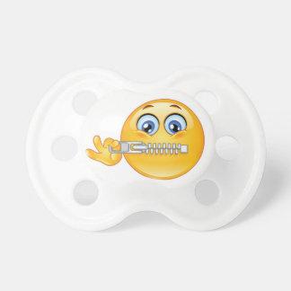 Reißverschluss zugemachte nahe Emoji Attrappe, Schnuller