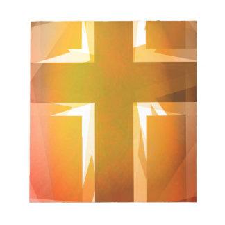 Rotes und gelbes religiöses Kreuz Notizblock