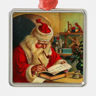 Sankt, die seine Listen-Weihnachtsverzierung macht Silbernes Ornament