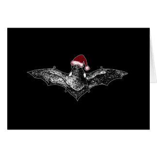 Schläger in einer Weihnachtsmannmütze Karte