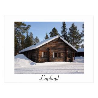 Schneebedecktes Blockhaus in der Postkarte