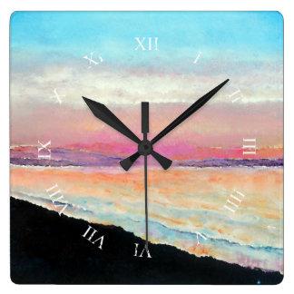 Schöner Sonnenuntergang malte in der weichen Uhr