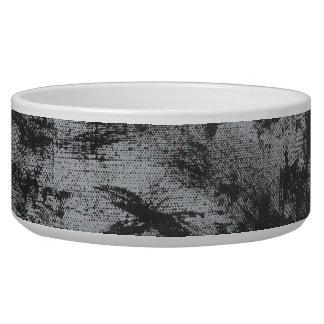 Schwarze Tinte auf grauem Hintergrund Napf