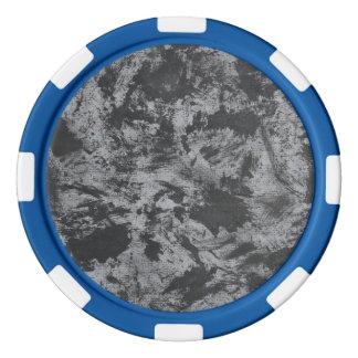 Schwarze Tinte auf grauem Hintergrund Pokerchips