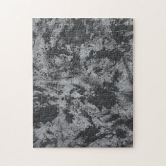 Schwarze Tinte auf grauem Hintergrund Puzzle