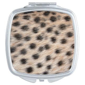 schwarzer gepunkteter Cheetahpelz oder Taschenspiegel