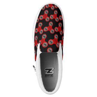 Schwarzer roter Unruhe-Spinner-Spielzeug-Beleg auf Slip-On Sneaker