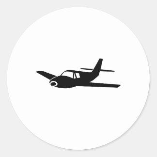 Schwarzes Flugzeug Runder Aufkleber