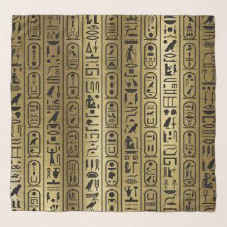 Schwarzes Hieroglyphenmuster auf altem Gold Schal