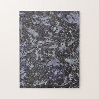 Schwarzweiss-Tinte auf lila Hintergrund Puzzle