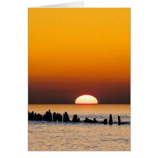 Sonnenuntergang mit Angler auf Ufer der Ostsee Grußkarte