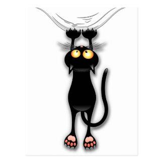 Spaß-schwarze Katze, die unten Postkarte fällt