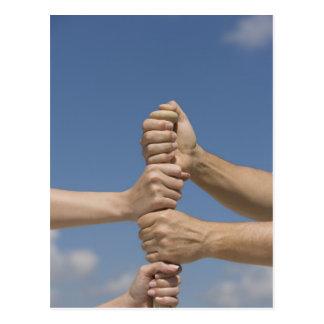 Team-Hände auf Schläger Postkarte