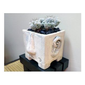 Topf-Kopf mit Kaktus durch die perfekte Pflanze Postkarte