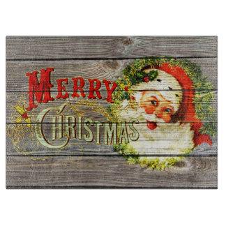 Vintage frohe Weihnachten u. Sankt auf rustikalem Schneidebrett