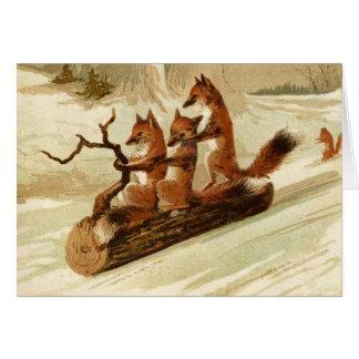 Vintage Füchse, die Weihnachtskarte Sledding sind Karte