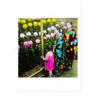 Vintage japanische Familie an der Postkarte