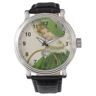 Vintages Mädchen mit grünen Hutkleidst patrick Tag Armbanduhr