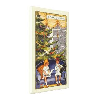 Vintages Weihnachten, Kinder, die auf einer Couch Leinwanddruck
