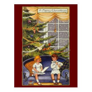 Vintages Weihnachten, Kinder, die auf einer Couch Postkarte