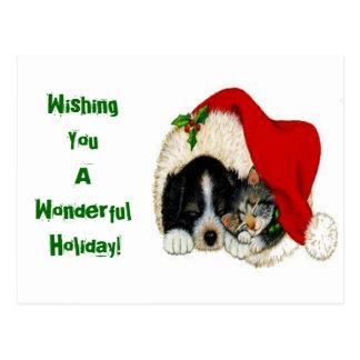 Weihnachtsfeiertags-Katze und Hundepostkarte Postkarte