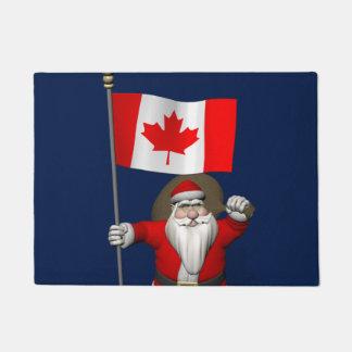 Weihnachtsmann, der Kanada besichtigt Türmatte
