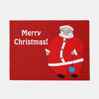 Weihnachtsmann wünscht Besuchern frohen Türmatte