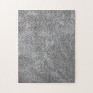Weiße Tinte auf silbernem Hintergrund Puzzle