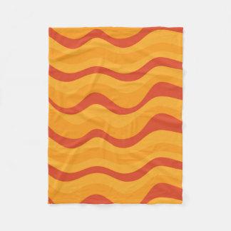 Wellen-Muster in den gelb-orangeen Herbst-Farben Fleecedecke