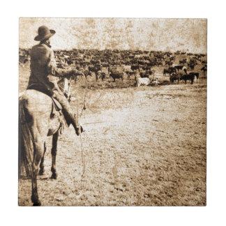 Zuhause auf dem Strecken-Vintager Cowboy-alten Fliese